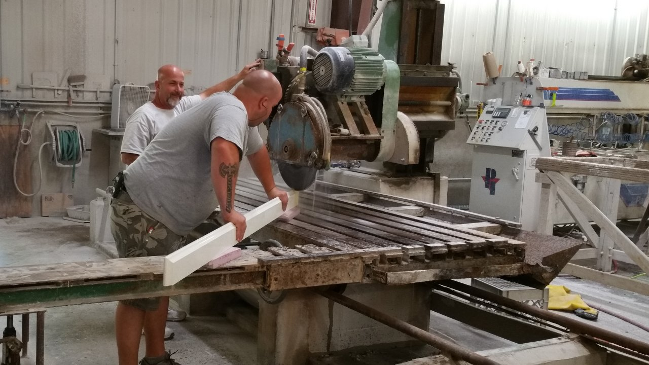 Team members in our fabrication shop work on mitre cuts
